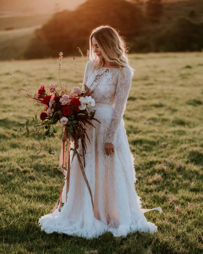 Bride with bouquet by Bower Botanicals at byronviewfarm